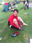 Tim Martin with the pair of shoes donated to him by Martin Stone after his fell apart on Day 1