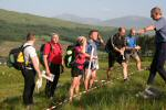 Controller Andy Spenceley directs teams at the Bridge of Orchy start
