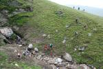 Teams cross a washed out gully