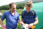 Race Director Martin Stone discusses the Elite course with Mark Hartell at the Day 1 finish