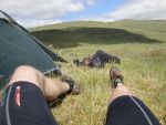 Euan Cameron (D5) stretches his legs after the first day while Andy Cochrane grabs a nap at MidCamp